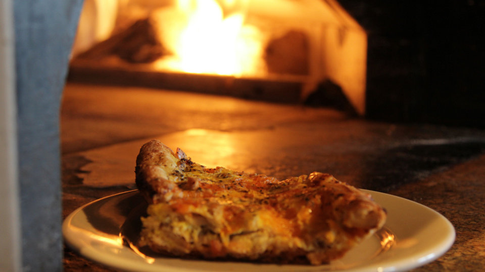 Food comes out of the wood-fired oven at The Wedge Pizzeria, 4709 N Western. Photo by Dave Morris, NewsOK.com/The Oklahoman Dave Morris