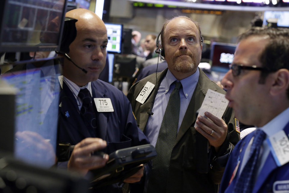 Photo - Trader Andrew O'Connor, center, works on the floor of the New York Stock Exchange, Tuesday, Aug. 27, 2013. Worries about a potential military strike against Syria are dragging down the U.S. stock market in early trading. (AP Photo/Richard Drew)