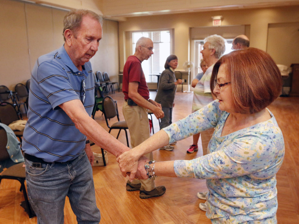 Photo -  Lee Gans and Suzi Robnett practice self-defense techniques during a class taught by Gene Schultingkemper, a sixth-degree black belt, at the Edmond Senior Center. Photo by Paul Hellstern, The Oklahoman   PAUL HELLSTERN -