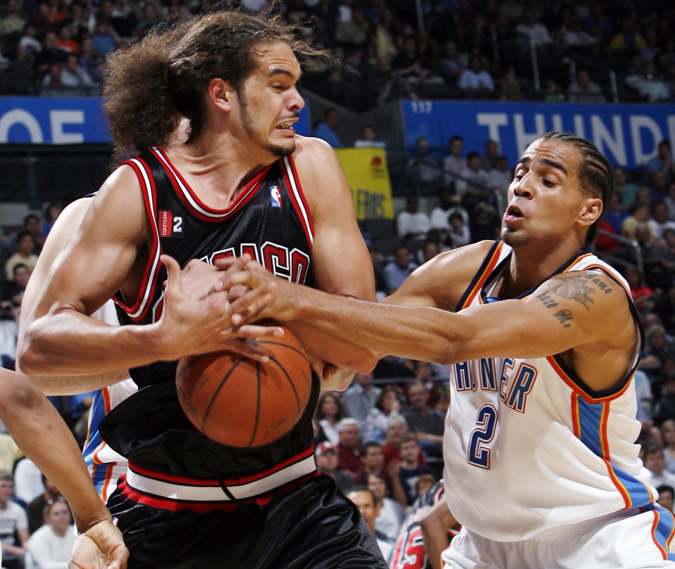 Photo - Oklahoma City's Thabo Sefolosha (2) tries to knock the ball away from Joakim Noah (13) of Chicago in the second half of the NBA basketball game between the Chicago Bulls and the Oklahoma City Thunder at the Ford Center in Oklahoma City, Wednesday, March 18, 2009. Chicago won, 103-96. PHOTO BY NATE BILLINGS, THE OKLAHOMAN