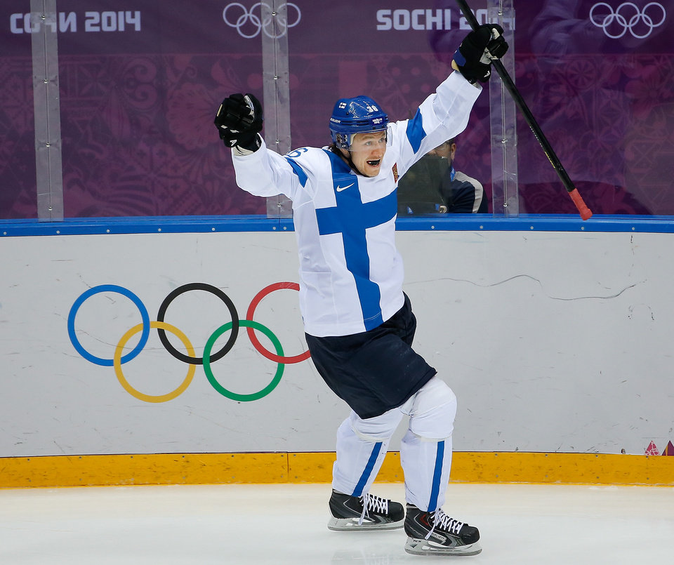 Photo - Jussi Jokinen of Finland celerates his goal against the United States during the second period of the men's bronze medal ice hockey game at the 2014 Winter Olympics, Saturday, Feb. 22, 2014, in Sochi, Russia. (AP Photo/Matt Slocum)