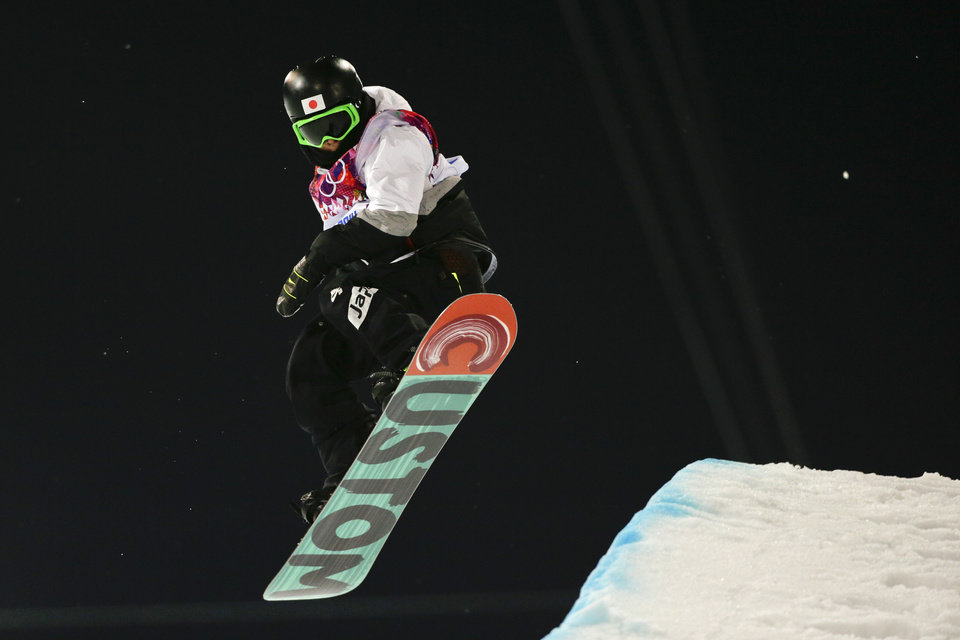 Photo - Japan's Ayumu Hirano competes during the men's snowboard halfpipe final at the Rosa Khutor Extreme Park, at the 2014 Winter Olympics, Tuesday, Feb. 11, 2014, in Krasnaya Polyana, Russia. Ayumu Hirano won the silver medal. (AP Photo/Jae C. Hong)