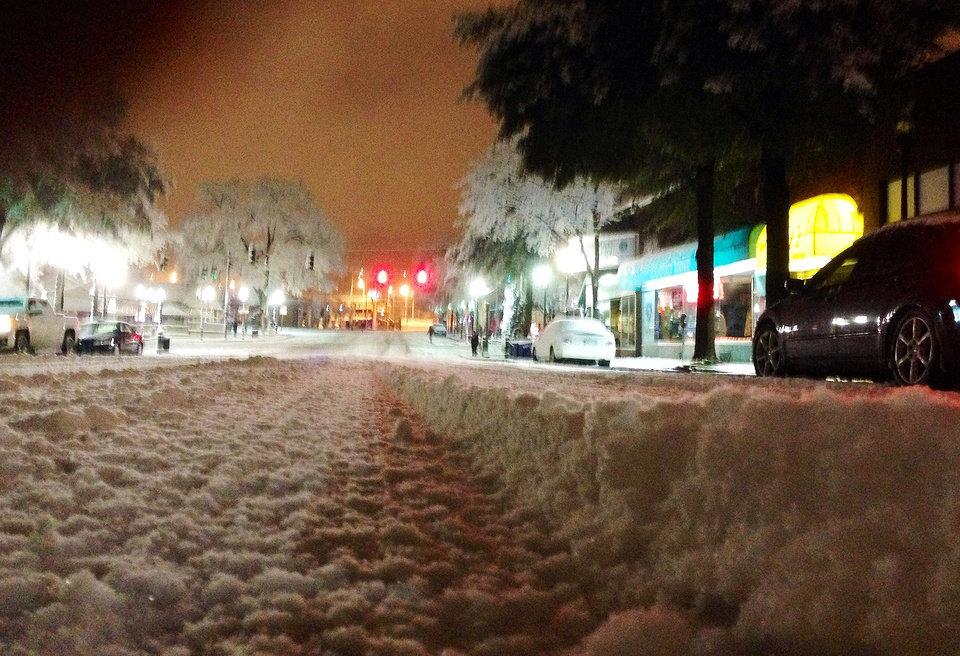 Photo - Snow blankets a street in downtown Birmingham, Ala., on Wednesday, Feb. 12, 2014. Snow and ice covered the northern half of the state, forcing authorties to close roads and prompting another day of school and business closings. (AP Photo/Jay Reeves)