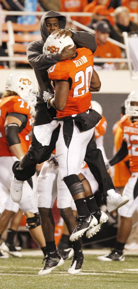 Photo - Andre Sexton (20) gets a bump from a teammate after stopping Missouri during the college football game between Oklahoma State University (OSU) and the University of Missouri (MU) at Boone Pickens Stadium in Stillwater, Okla. Saturday, Oct. 17, 2009.  Photo by Doug Hoke, The Oklahoman