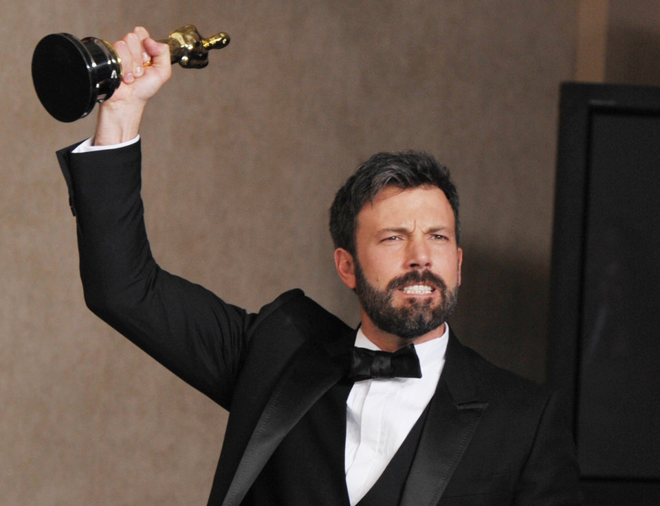 Photo - FILE - In this Feb. 24, 2013 file photo, Ben Affleck poses with his award for best picture for