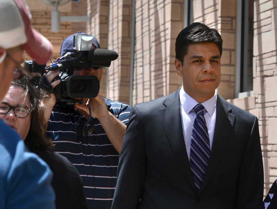 Photo - Jamie Estrada, 41, of Los Lunas, N.M., leaves Federal Court in Albuquerque, N.M., Monday June 16, 2014,  after pleading guilty to the unlawful interception of electronic communications and false statements charges arising out of the unlawful interception of emails intended for others, including New Mexico Governor Susana Martinez and members of her staff.   (AP Photo/The Albuquerque Journal, Greg Sorber)