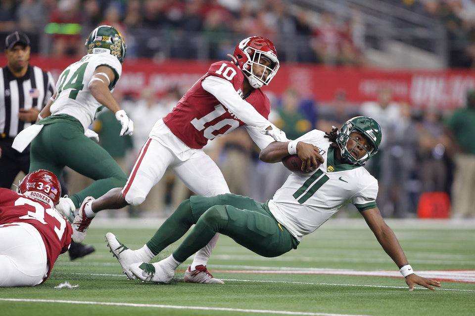 Photo - Oklahoma's Pat Fields (10) brings down Baylor's Gerry Bohanon (11) during the Big 12 Championship Game between the University of Oklahoma Sooners (OU) and the Baylor University Bears at AT&T Stadium in Arlington, Texas, Saturday, Dec. 7, 2019. Oklahoma won 30-23. [Bryan Terry/The Oklahoman]