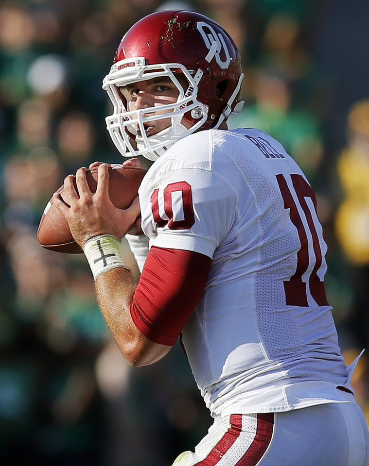 Photo - Oklahoma's Blake Bell (10) looks to pass during a college football game between the University of Oklahoma Sooners (OU) and the Notre Dame Fighting Irish at Notre Dame Stadium in South Bend, Ind., Saturday, Sept. 28, 2013. Photo by Nate Billings, The Oklahoman