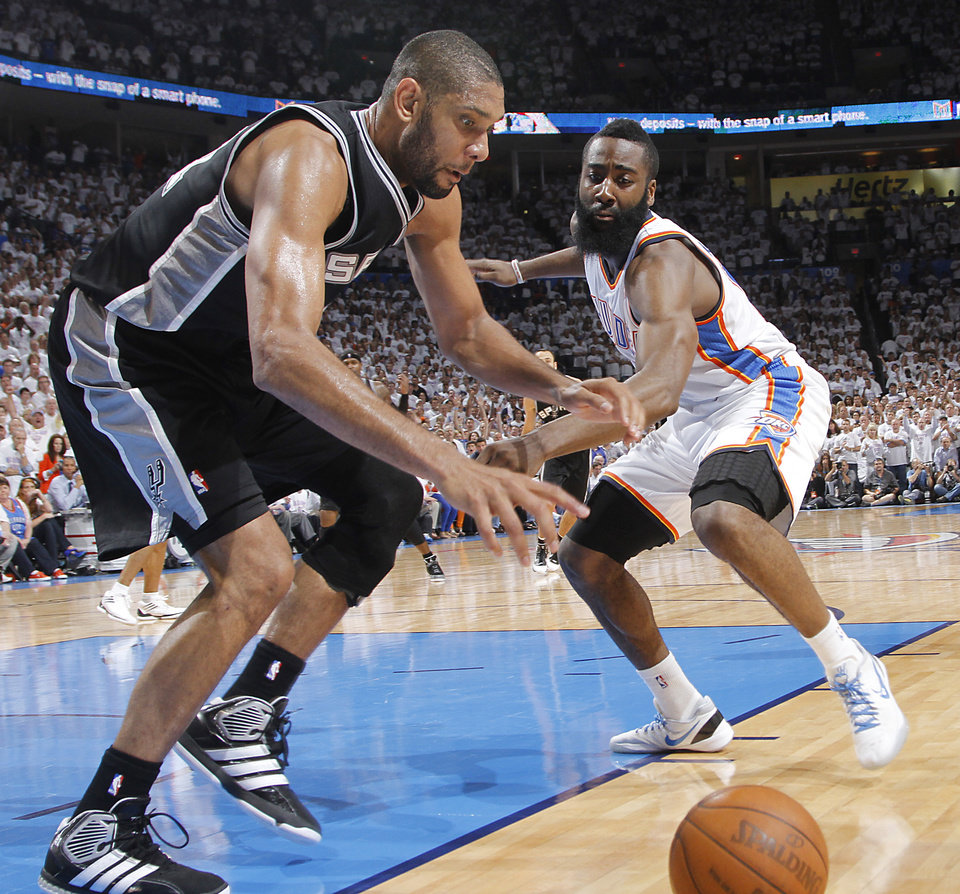 Oklahoma City's James Harden (13) defends on San Antonio's Tim Duncan (21) during Game 6 of the Western Conference Finals between the Oklahoma City Thunder and the San Antonio Spurs in the NBA playoffs at the Chesapeake Energy Arena in Oklahoma City, Wednesday, June 6, 2012. Photo by Chris Landsberger, The Oklahoman