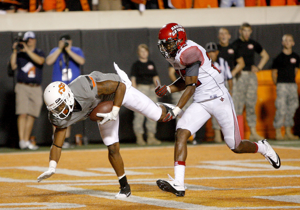 Photo - Oklahoma State's Michael Harrison scores a touchdown in front of Louisiana-Lafayette's Melvin White in the second half. Photo by Sarah Phipps, The Oklahoman