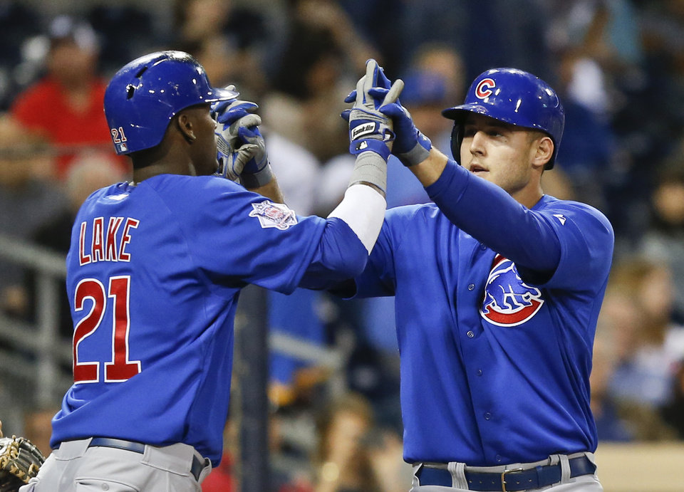 Photo - Chicago Cubs' Anthony Rizzo is congratulated by Junior Lake as he crosses home plate with a two run home run against then San Diego Padres in the fourth inning of a baseball game Thursday, May 22, 2014, in San Diego.  (AP Photo/Lenny Ignelzi)