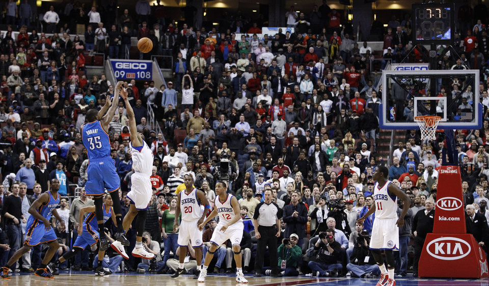 Oklahoma City Thunder's Kevin Durant (35) shoots the game-tying three-pointer over Philadelphia 76ers' Andre Iguodala in the second half of an NBA basketball game, Wednesday, March 9, 2011, in Philadelphia. Oklahoma City won  110-105 in overtime. (AP Photo/Matt Slocum)