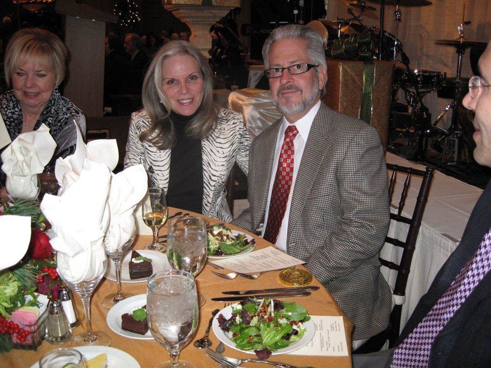STAN HUPFELD'S PARTY...Laurel Kallenberger and Dennis Johnson enjoy  their salad at the party honoring Stan Hupfeld. (Photo by Helen Ford  Wallace).