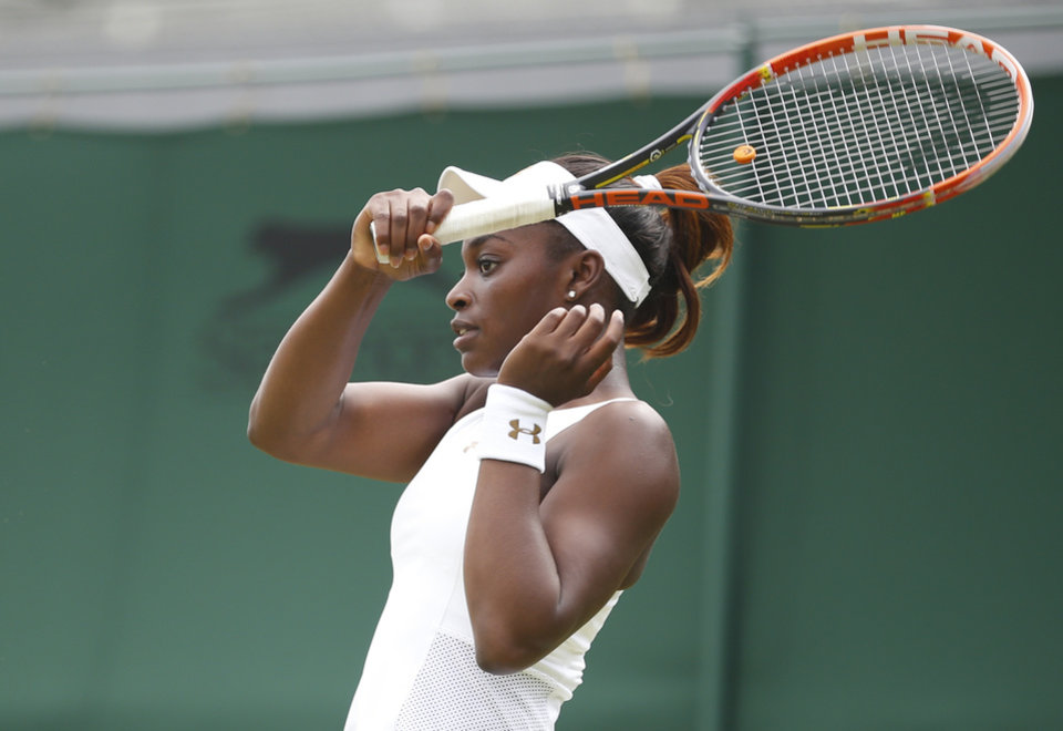 Photo - Sloane Stephens of the U.S. looks after ball during her first round match against Russia's Maria Kirilenko at the All England Lawn Tennis Championships in Wimbledon, London,  Monday, June  23, 2014. (AP Photo/Pavel Golovkin)