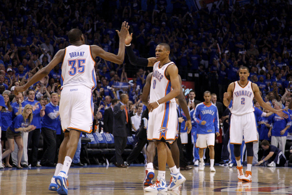 Photo - Oklahoma City's Russell Westbrook (0) and Kevin Durant (35) celebrate after Westbrook hit a basket in the final seconds of the NBA basketball game between the Denver Nuggets and the Oklahoma City Thunder in the first round of the NBA playoffs at the Oklahoma City Arena, Sunday, April 17, 2011. Photo by Bryan Terry, The Oklahoman