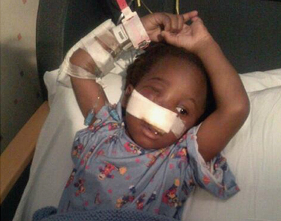 Photo - This family handout photo provided by Rev. Corey Brooks shows 3-year-old Deonta Howard recovering from a gunshot wound Monday, Sept. 23, 2013 at Mt. Sinai Hospital in Chicago. Howard was among 13 people shot Thursday night, Sept. 19, 2013, at Cornell Square Park on Chicago's southwest side. Two men were charged Monday, Sept. 23 with attempted murder and aggravated battery with a firearm in the shooting. (AP Photo/Family photo via Rev. Corey Brooks)