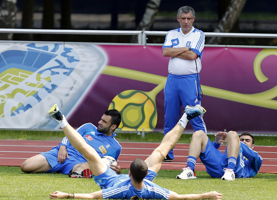 Greece's coach Fernando Santos watches his players during a training session at the Euro 2012 soccer championship in Legionowo about 25 kilometers (15 miles) north of Warsaw, Poland on Monday, June 18, 2012. (AP Photo/Thanassis Stavrakis)