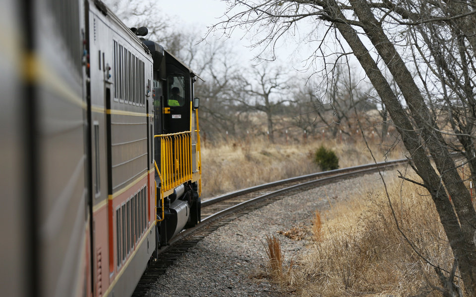 Photo - A view outside as the train follows a curve on a demonstration ride of the Eastern Flyer passenger train from Sapulpa to the Oklahoma City metro area, Sunday, Feb. 23, 2014. Photo by Nate Billings, The Oklahoman
