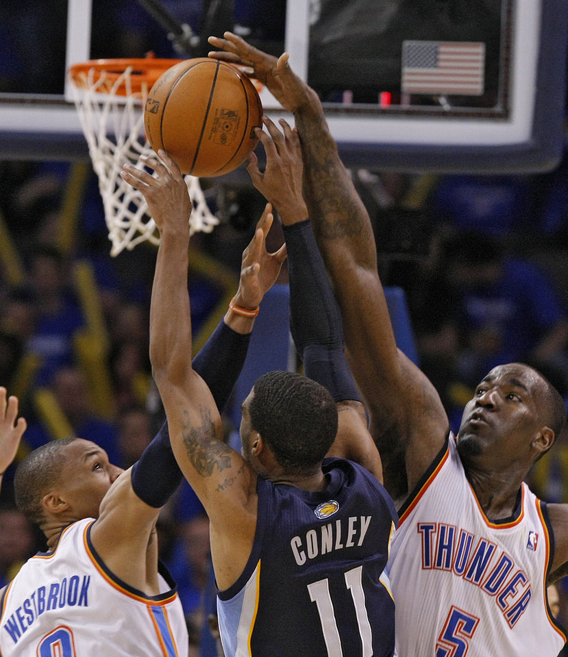 Photo - Oklahoma City's Russell Westbrook (0) and Oklahoma City's Kendrick Perkins (5) defend Mike Conley (11) of Memphis during game two of the Western Conference semifinals between the Memphis Grizzlies and the Oklahoma City Thunder in the NBA basketball playoffs at Oklahoma City Arena in Oklahoma City, Tuesday, May 3, 2011. Photo by Chris Landsberger, The Oklahoman