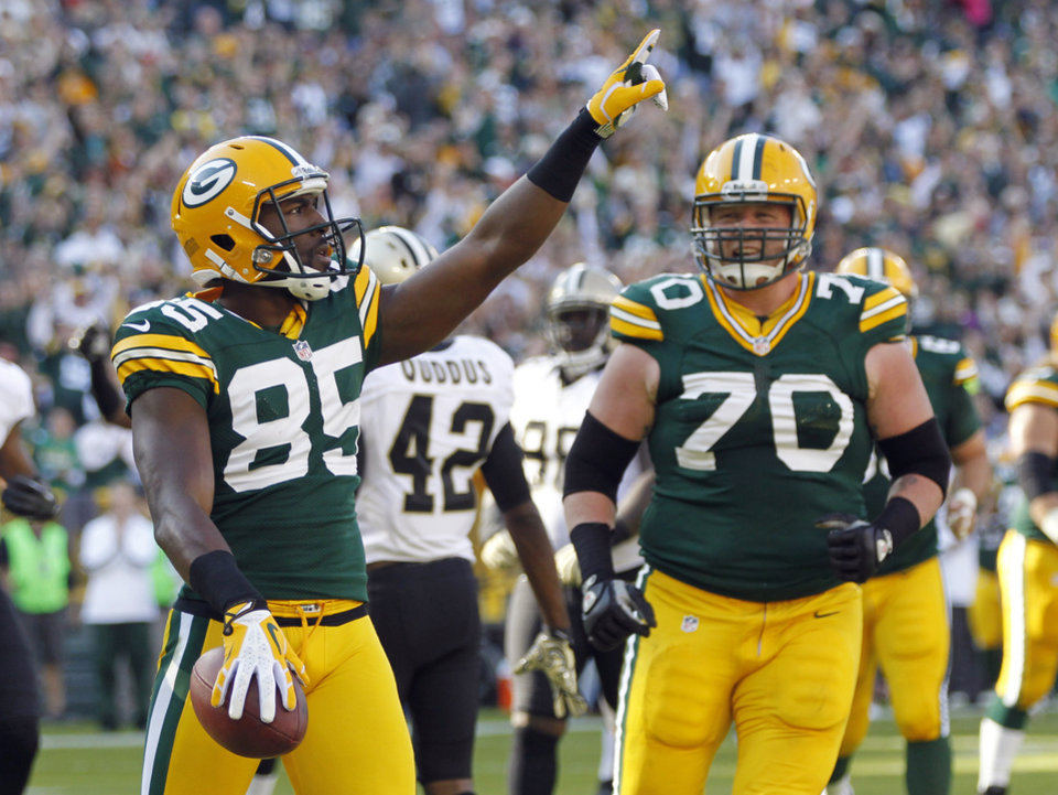 Green Bay Packers wide receiver Greg Jennings celebrates a touchdown reception with guard T.J. Lang during the first half of an NFL football game against the New Orleans Saints on Sunday, Sept. 30, 2012, in Green Bay, Wis. (AP Photo/Mike Roemer)