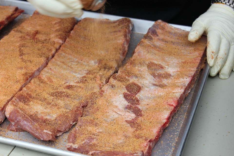 Seasoned ribs prepare for a trip into the smoker. PHOTO BY DANIEL PUMA, FOR THE OKLAHOMAN <strong>DANIEL PUMA - THE OKLAHOMAN</strong>
