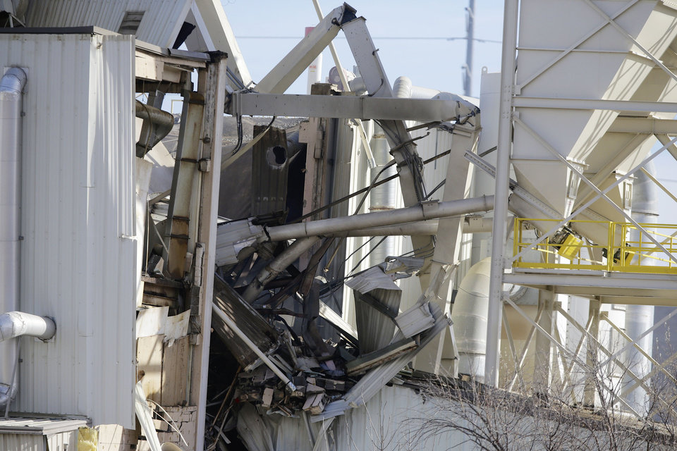 Photo - The International Nutrition plant is in wreckage  in Omaha, Neb., where a fire and explosion took place Monday, Jan. 20, 2014. At least nine people have been hospitalized and others could be trapped at the animal feed processing plant. (AP Photo/Nati Harnik)