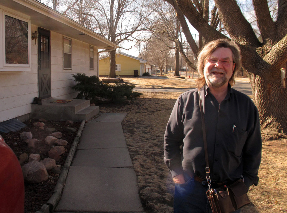 Photo - Steve Skoda stands outside of his vacation home in Lincoln, Neb. on Wednesday, March 19, 2014. Skoda, 57, said he was notified earlier in the year that his flood insurance premium would be increasing by more than 20 percent because the home lies in a flood plain, and it isn't his primary residence.