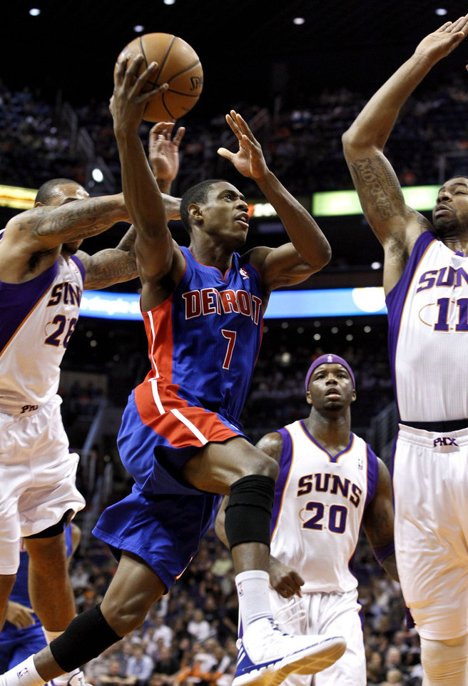Detroit Pistons' Brandon Knight (7) tries to drive past Phoenix Suns' Markieff Morris (11), Shannon Brown (26) and Jermaine O'Neal (20) in the first half of an NBA basketball game on Friday, Nov. 2, 2012, in Phoenix. (AP Photo/Ross D. Franklin)
