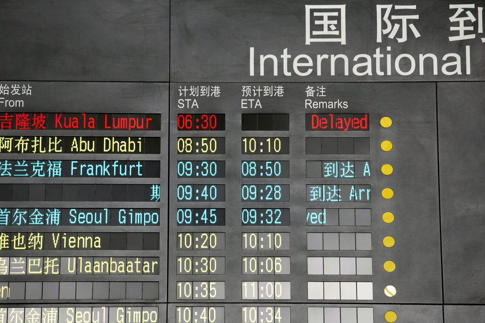 Photo - The arrival board at the International Airport in Beijing, China shows a Malaysian airliner is delayed, Saturday, March 8, 2014. A Malaysia Airlines Boeing 777-200 carrying 239 people lost contact with air traffic control early Saturday morning on a flight from Kuala Lumpur to Beijing, and international aviation authorities still hadn't located the jetliner several hours later. (AP Photo/Ng Han Guan)