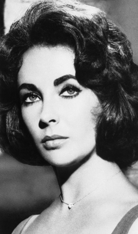 Elizabeth Taylor is shown in 1961 - AP Photo