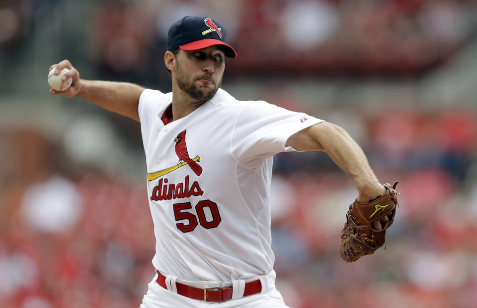 Photo - St. Louis Cardinals starting pitcher Adam Wainwright throws during the first inning of a baseball game against the Pittsburgh Pirates, Sunday, April 27, 2014, in St. Louis. (AP Photo/Jeff Roberson)