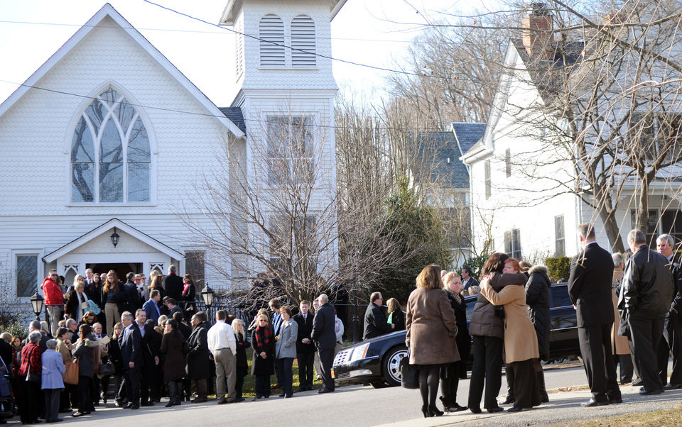 Photo - Mourners exit St. Mary Of The Assumption Church after the funeral of Anne Marie Murphy on Thursday, Dec. 20, 2012 in Katonah, N.Y.  Murphy was killed when Adam Lanza, walked into Sandy Hook Elementary School in Newtown, Conn., Dec. 14, and opened fire, killing 26, including 20 children, before killing himself.  (AP Photo/The Stamford Advocate, Lindsay Niegelberg) MANDATORY CREDIT