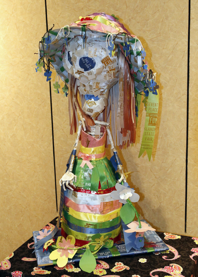This piece by Van Buren Elementary students Chloe Holden, Laura Mendoza, Carlos Trejo, Ashley Garza, and others, is part of a student art exhibit commemorating Day of the Dead on display Monday at the Plaza Mayor Fall Festival in Oklahoma City. Photo by Paul Hellstern, The Oklahoman <strong>PAUL HELLSTERN</strong>