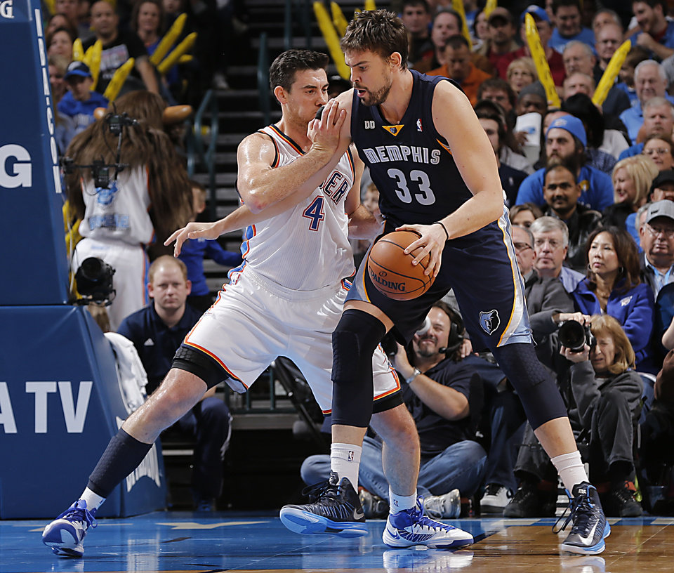 Photo - Oklahoma City's Nick Collison (4) defends on Memphis' Marc Gasol (33) during the NBA basketball game between the Oklahoma City Thunder and the Memphis Grizzlies at Chesapeake Energy Arena on Wednesday, Nov. 14, 2012, in Oklahoma City, Okla.   Photo by Chris Landsberger, The Oklahoman