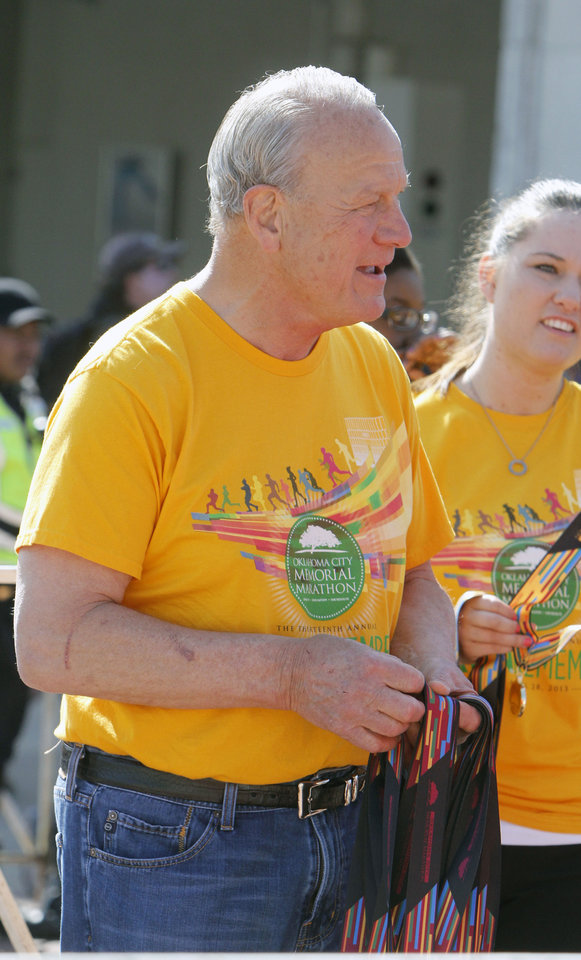 Photo - Former OU football coach Barry Switzer hands out medals during the Oklahoma City Memorial Marathon in Oklahoma City, Sunday, April 28, 2013,  By Paul Hellstern, The Oklahoman