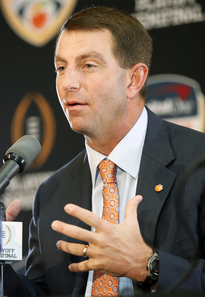 Photo - Clemson coach Dabo Swinney speaks during a news conference for the Capital One Orange Bowl, a College Football Playoff Semifinal game, at the Renaissance Fort Lauderdale Cruise Port Hotel in Fort Lauderdale, Florida, Wednesday, Dec. 30, 2015. The Oklahoma Sooners will play the Clemson Tigers on News Year's Eve. Photo by Nate Billings, The Oklahoman
