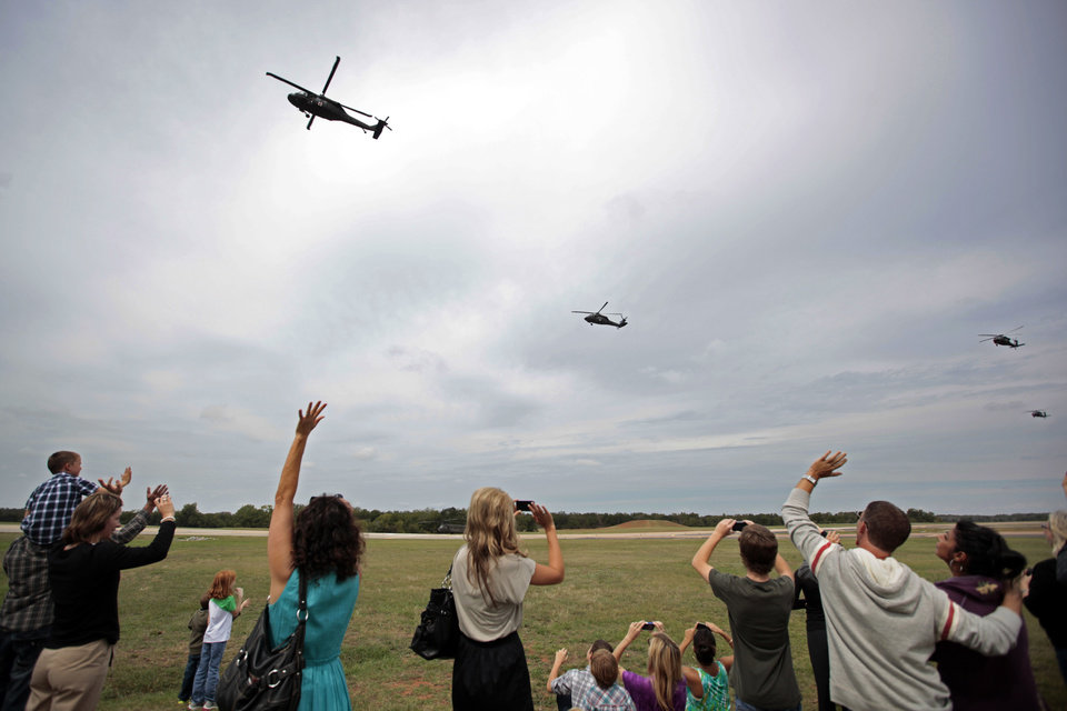 Family and friends wave goodbye to soldiers following an Oklahoma Aviation Command mobilization ceremony  for Detachment 1, Company C, 2-149th General Support Aviation Battalion at the Army Aviation Support Facility in Lexington, Okla.,  Sunday, Sept. 16, 2012. The soldiers will receive additional training at Fort Hood before being deployed to Afghanistan. Photo by Sarah Phipps, The Oklahoman