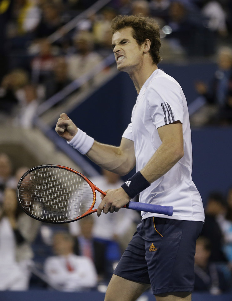 Photo -   Britain's Andy Murray reacts while playing Serbia's Novak Djokovic during the championship match at the 2012 US Open tennis tournament, Monday, Sept. 10, 2012, in New York. (AP Photo/Mike Groll)