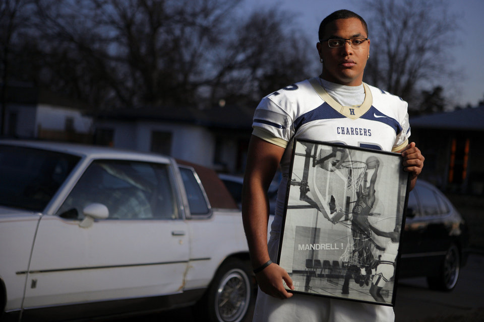 Quintaz Struble holds a photo of his father Mandrell Dean in front of his 1986 Cutlass Supreme in Oklahoma City home on Thursday, Jan. 12, 2012. Photo by Bryan Terry, The Oklahoman