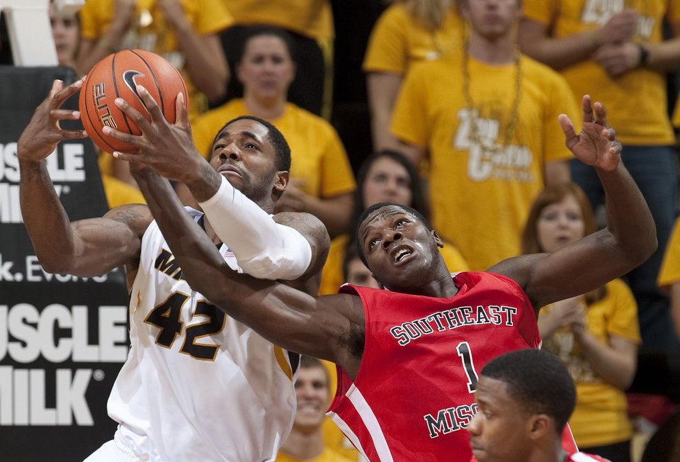 Missouri's Alex Oriakhi, left, and Southeast Missouri State's Nino Johnson, right, vie for a rebound during the second half of an NCAA college basketball game Tuesday, Dec. 4, 2012, in Columbia, Mo. Missouri won 81-65.  (AP Photo/L.G. Patterson)
