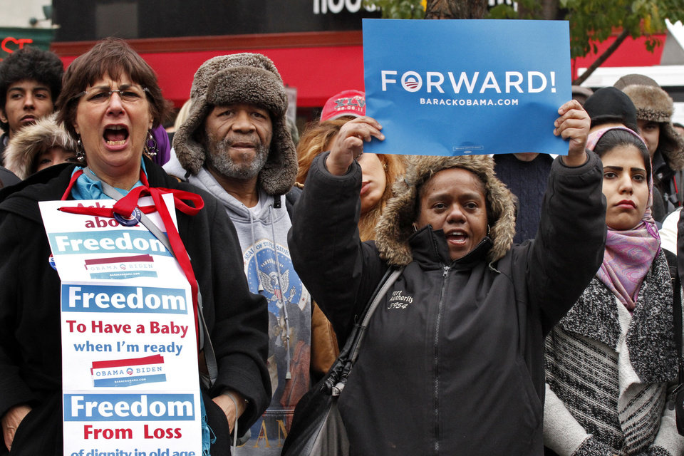Photo -   Supporters of President Barack Obama cheer during a visit by former President Bill Clinton to a rally to get out the vote for President Obama, Monday, Nov. 5, 2012, in downtown Pittsburgh. (AP Photo/Gene J. Puskar)