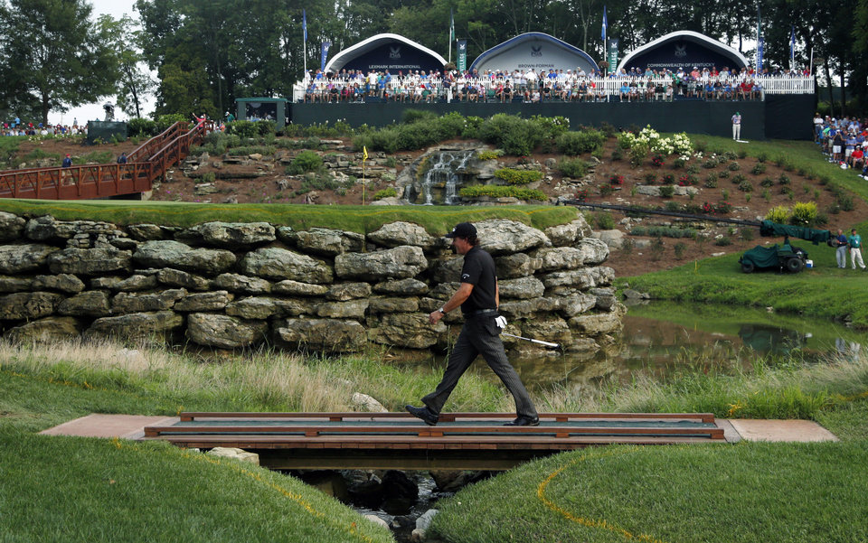 Photo - Phil Mickelson walks to 13th green during the final round of the PGA Championship golf tournament at Valhalla Golf Club on Sunday, Aug. 10, 2014, in Louisville, Ky. (AP Photo/Mike Groll)