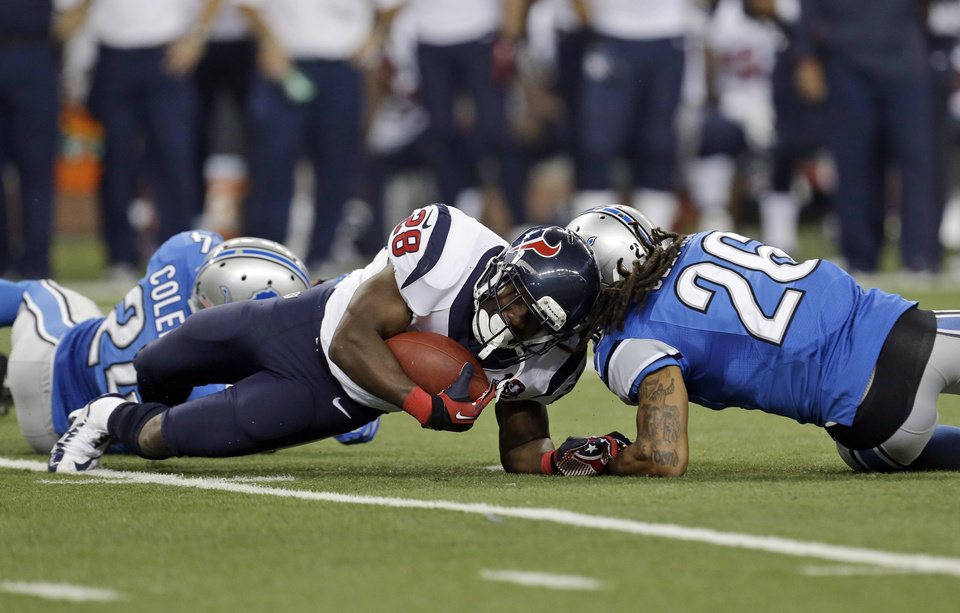 Photo -   Houston Texans running back Justin Forsett (28) is hit by Detroit Lions free safety Louis Delmas (26) during the third quarter of an NFL football game at Ford Field in Detroit, Thursday, Nov. 22, 2012. Forsett scored an 81-yard touchdown run on the play. (AP Photo/Paul Sancya)
