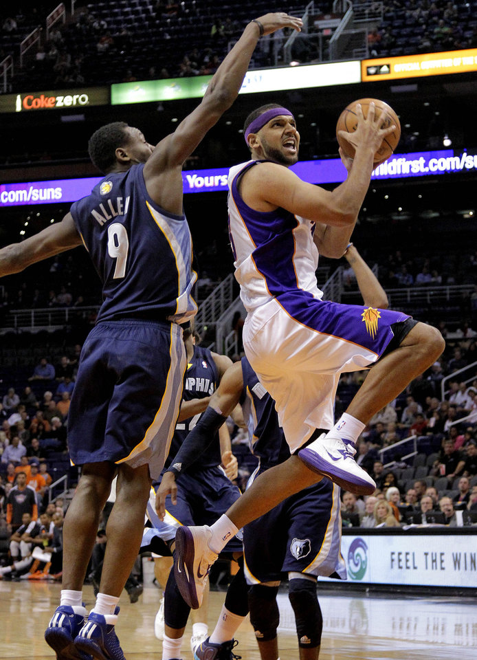 Phoenix Suns' Jared Dudley, right, drives past Memphis Grizzlies' Tony Allen (9) during the second half of an NBA basketball game on Wednesday, Dec. 12, 2012, in Phoenix. (AP Photo/Matt York)