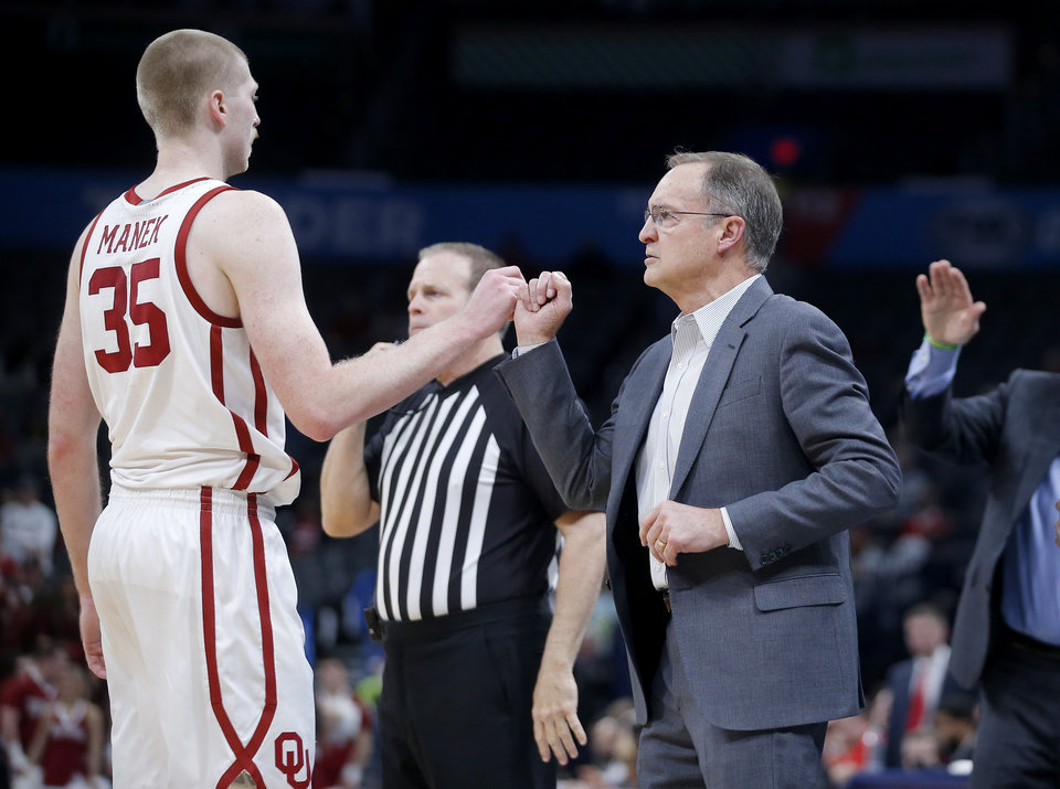 Photo - Oklahoma coach Lon Kruger fist bumps  Oklahoma's Brady Manek (35) during a men's NCAA college basketball game between the University of Oklahoma Sooners (OU) and the Texas Tech Red Raiders at Chesapeake Energy Arena in Oklahoma City, Tuesday, Feb. 25, 2020. Oklahoma won 65-51. [Bryan Terry/The Oklahoman]
