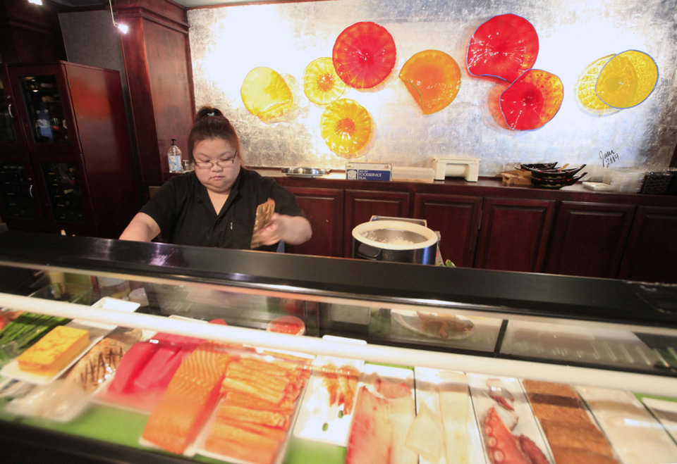 Sammie Tam, sushi chef, prepares sushi in this 2010 photo at the Grand House China Bistro in the Asian district in Oklahoma City. Photo by Paul B. Southerland, The Oklahoman  Archives <strong>PAUL B. SOUTHERLAND - PAUL B. SOUTHERLAND</strong>