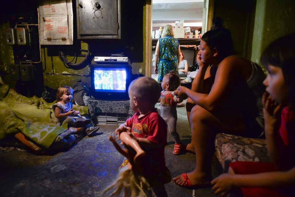Photo - Families with children hide in the bomb shelter in Petrovskiy district in Donetsk, eastern Ukraine, Monday Sept. 1, 2014. The Petrovskiy district of Donetsk is currently a frontline and one of the districts which has suffered the most from the artillery fights between Ukrainian army and Pro-Pussian rebels. (AP Photo/Mstislav Chernov)