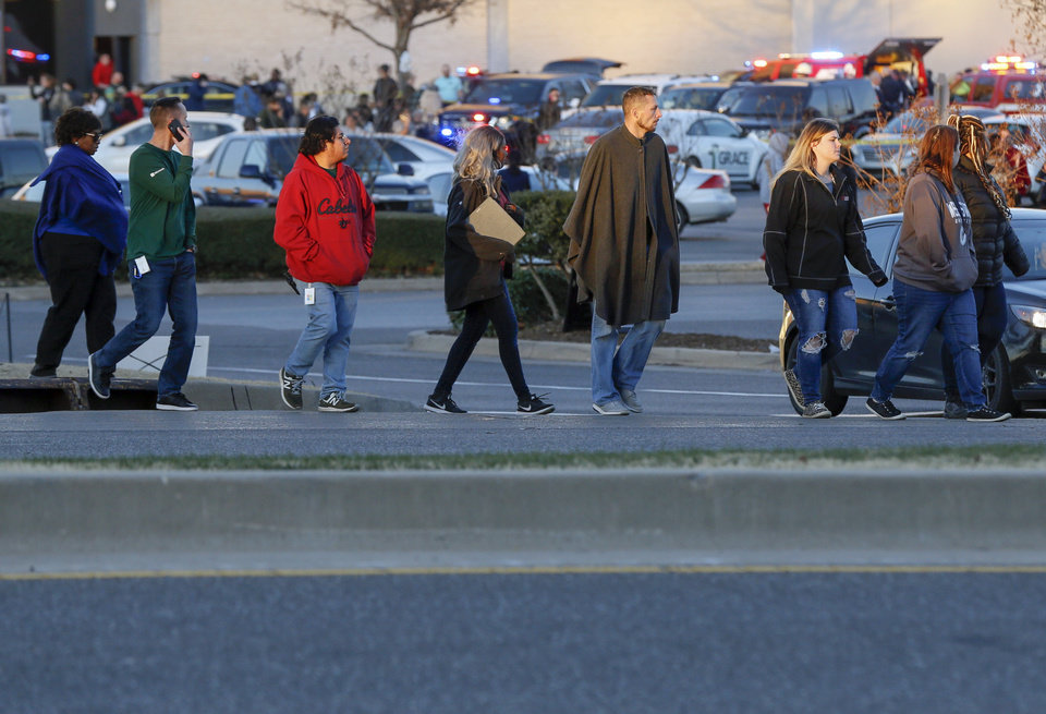 Photo - People cross Northwest Expressway after a shooting inside Penn Square Mall in Oklahoma City, Thursday, Dec. 19, 2019. [Nate Billings/The Oklahoman]
