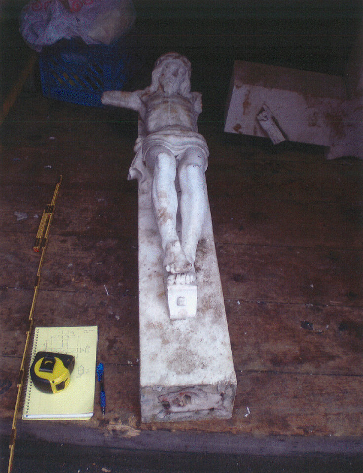 Photo -   An outdoor crucifix that used to stand at St. Patrick's Church in the city of Newburgh, N.Y. is seen in an undated photo provided by the Kitson Law Firm. David Jiminez, an immigrant from Mexico, was so elated over his wife's recovery from cancer that he offered to clean the large crucifix outside St. Patrick's Church in Newburgh, where he spent many hours praying for her to beat the disease. He was scrubbing grime off the 600-pound marble cross when it toppled onto him, crushing his right leg, which had to be amputated. Jimenez is now suing the Roman Catholic church where he was hurt, and his $3 million lawsuit is scheduled to go to trial next year. (AP Photo/Kitson Law Firm)