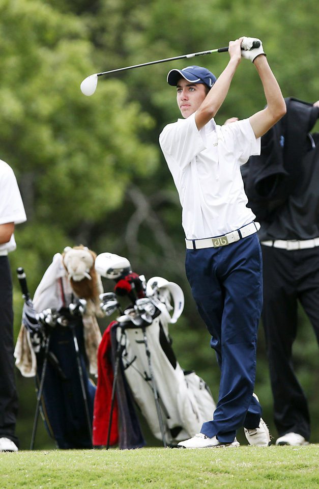 Photo - John-Crawford Counts of Southmoore tees off at the 6A Golf State Championship at Karsten Creek, Monday, May 12, 2014, in Stillwater. Photo by KT King, For The Tulsa World